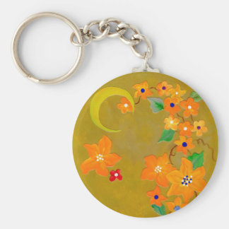 orange flowering vine with crescent moon key ring
