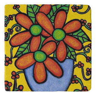 Orange Flowers In Blue Vase On Yellow Trivet
