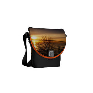Orange sunset over the Lake Courier Bags