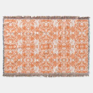 orange white throw blanket