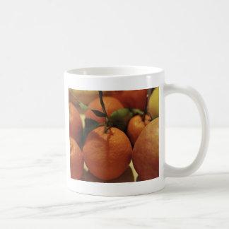 Oranges apples fruit on a table basic white mug