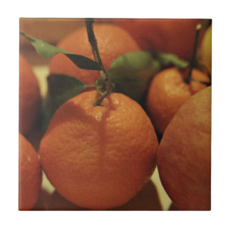 Oranges apples fruit on a table ceramic tile