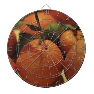 Oranges apples fruit on a table dart boards