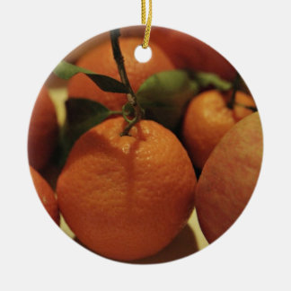 Oranges apples fruit on a table christmas tree ornaments