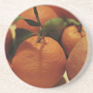 Oranges apples fruit on a table drink coasters