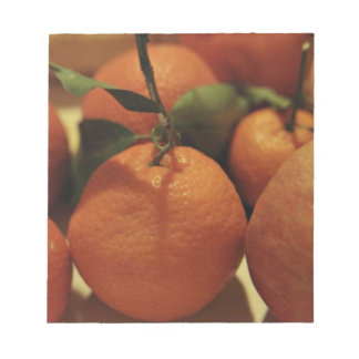 Oranges apples fruit on a table notepads