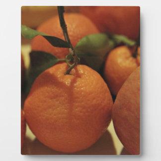 Oranges apples fruit on a table plaque