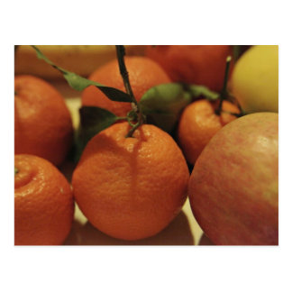Oranges apples fruit on a table postcard