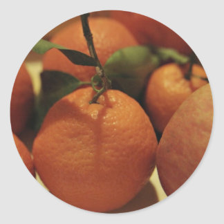 Oranges apples fruit on a table round sticker