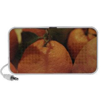 Oranges apples fruit on a table mp3 speaker