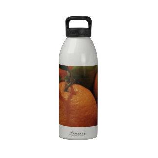 Oranges apples fruit on a table water bottles