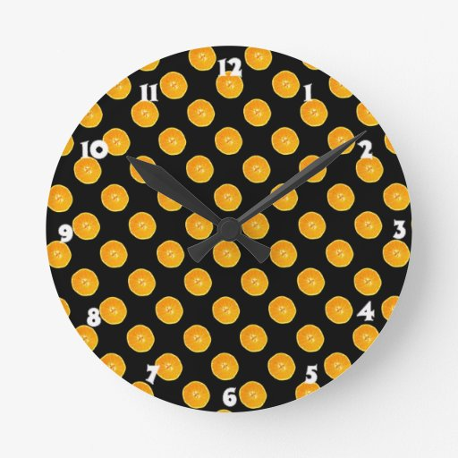 Oranges with black background round wall clocks