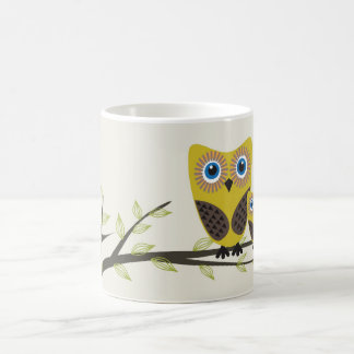 Owls couple on the tree. coffee mug