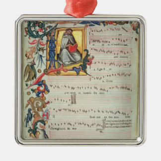 Page of musical notation with a historiated christmas ornament