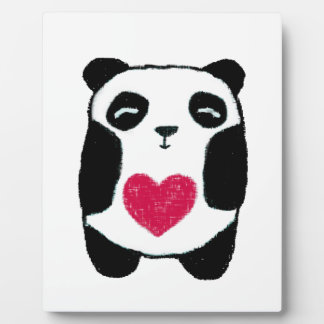 Panda bear with a heart plaque