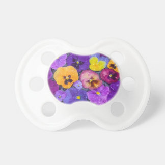 Pansy flowers floating in bird bath with dew dummy