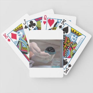 Pastry chef decorating a glazed chocolate cake bicycle playing cards