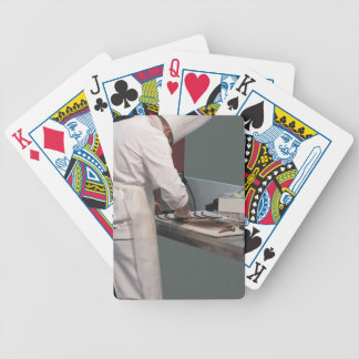 Pastry chef in the kitchen bicycle playing cards