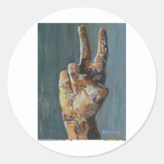 Peace symbol hand round sticker