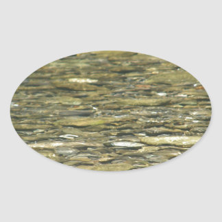 Peaceful River: Water and Rock Oval Sticker