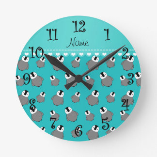 Personalized name turquoise baby penguins round clock