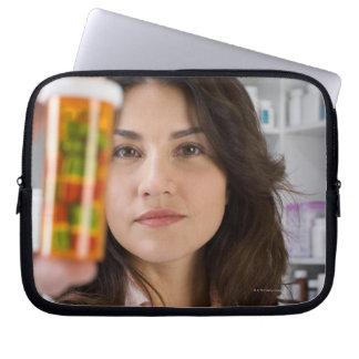 Pharmacist holding a pill bottle computer sleeve