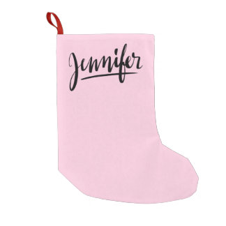 Pink Christmas stocking with the name Jennifer