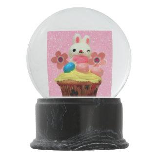 Pink cupcake bunny snow globe snow globes