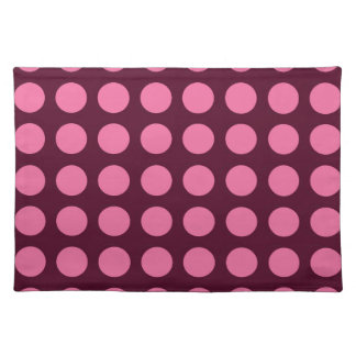 Pink polka dots on a brown background placemat