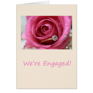 pink rose and rings engagement announcement