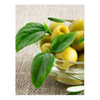 Pitted olives with green leaves and rosemary postcard