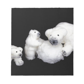 Polar bears family figurines playing with snowball notepads
