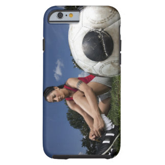 portrait of female football player tying her tough iPhone 6 case