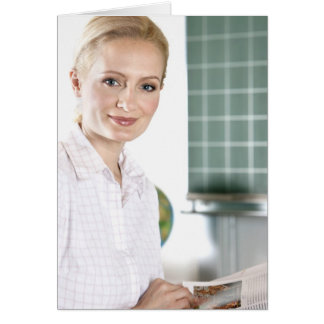 portrait of young female teacher in classroom greeting cards