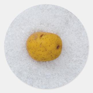 Potato macro as background with salt round sticker