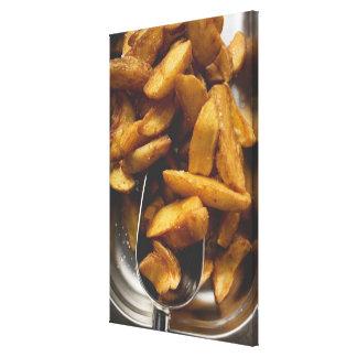 Potato wedges with salt (detail) canvas print