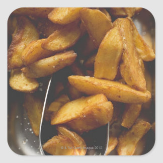 Potato wedges with salt (detail) square sticker
