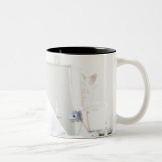 Pupil in a science lesson. Two-Tone coffee mug