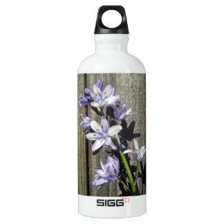 Purple Bluebell against old gate Water Bottle