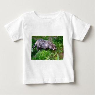 Raccoon dog on grass baby T-Shirt