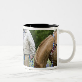 Ranchers shaking hands across the fencing in Two-Tone coffee mug