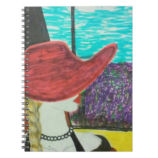 Red hat model traveling by train notebooks