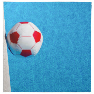 Red-white beach ball floating  in swimming pool napkin