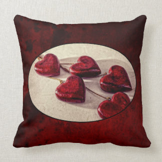 Red Wooden Hearts Tied Together on a String Pillow