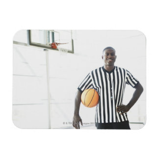 Referee holding basketball on court rectangular photo magnet