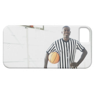 Referee holding basketball on court iPhone 5 cases