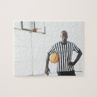 Referee holding basketball on court puzzle