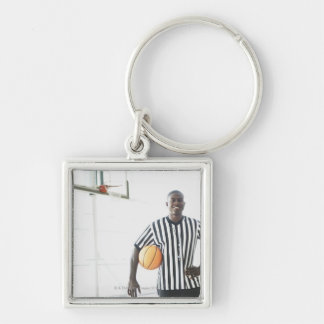 Referee holding basketball on court Silver-Colored square key ring