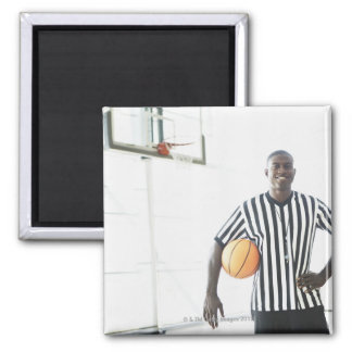 Referee holding basketball on court square magnet
