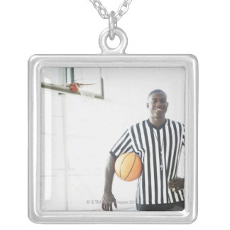Referee holding basketball on court square pendant necklace